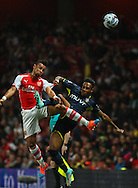 Francis Coquelin of Arsenal and Nathaniel Clyne of Southampton in an aerial battle during the Capital One Cup match at the Emirates Stadium, London<br /> Picture by David Horn/Focus Images Ltd +44 7545 970036<br /> 23/09/2014
