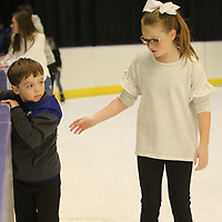 Chloe Childers, 10, helps her friend Graham Bumgardner, 6, skate Saturday at the Bancorpsouth Arena