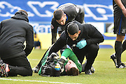 Bury Goalkeeper, Ian Lawlor gets medical attention after his goalmouth during the Sky Bet League 1 match between Wigan Athletic and Bury at the DW Stadium, Wigan, England on 27 February 2016. Photo by Mark Pollitt.
