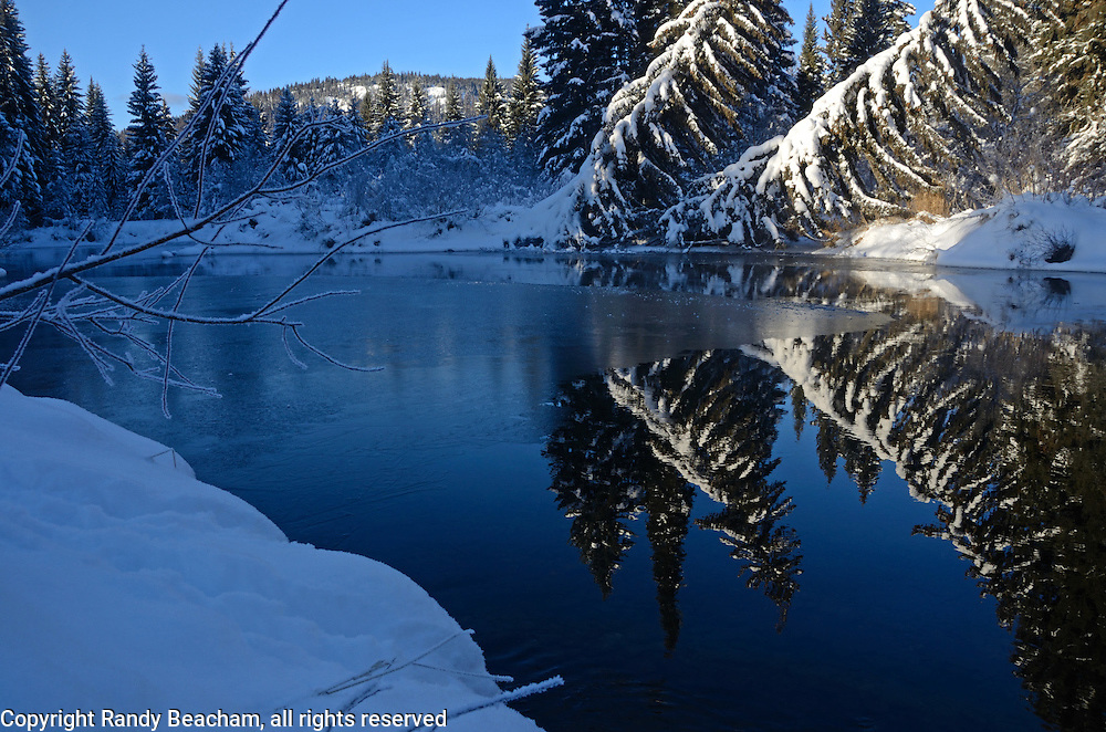 Yaak River at sunrise in winter. Yaak Valley in the Purcell Mountains, northwest Montana.