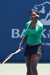 July 31, 2011; Stanford, CA, USA;  Serena Williams (USA) celebrates after a point against Marion Bartoli (FRA), not pictured, during the finals of the Bank of the West Classic women's tennis tournament at the Taube Family Tennis Stadium. Williams defeated Bartoli 7-5, 6-1.