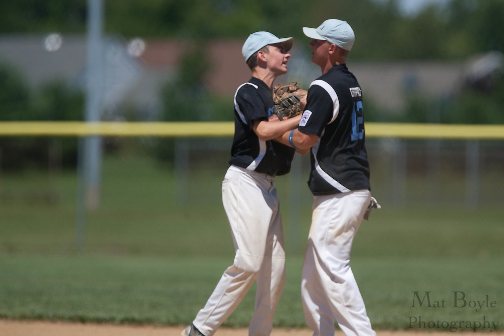 Pennsylvania's Mike Carey and Bart Chupka celebrate making an out during the winner take all final of the Eastern Regional Senior League tournament between Pennsylvania and Maryland held in West Deptford on Thursday, August 11.