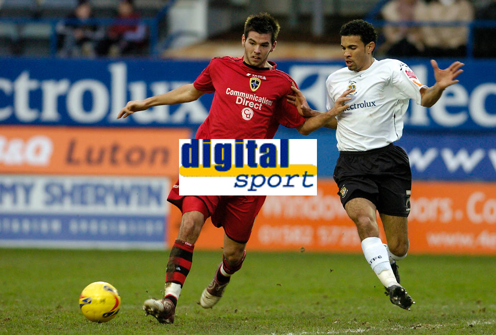 Photo: Leigh Quinnell.<br /> Luton Town v Cardiff City. Coca Cola Championship. 01/01/2007. Cardiffs Joe Ledley keeps the ball from Lutons Carlos Edwards.