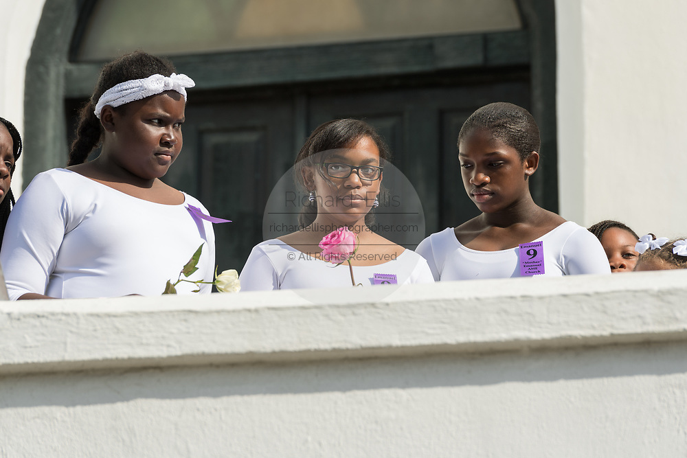 Young members of the praise dance group of the Mother Emanuel African Methodist Episcopal Church stand in front of the church during a ceremony marking the 2nd anniversary of the mass shooting June 17, 2017 in Charleston, South Carolina. Nine members of the historic African-American church were gunned down by a white supremacist during bible study on June 17, 2015.