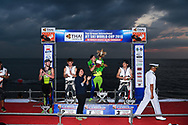 PATTAYA, THAILAND - DECEMBER 09: Mark Gomez of USA and Rickter reaction on the podium with the King's Cup during the Royal Trophy presentation for the Pro Freestyle second run at the Thai Airways International Jet Ski World Cup 2018, Jomtien Beach, Pattaya, Thailand on December 09, 2018. <br /> .<br /> .<br /> .<br /> (Photo by: Naratip Golf Srisupab/SEALs Sports Images)<br /> .<br /> Any image use must include a mandatory credit line adjacent to the content which should read: Naratip Golf Srisupab/SEALs Sports Images