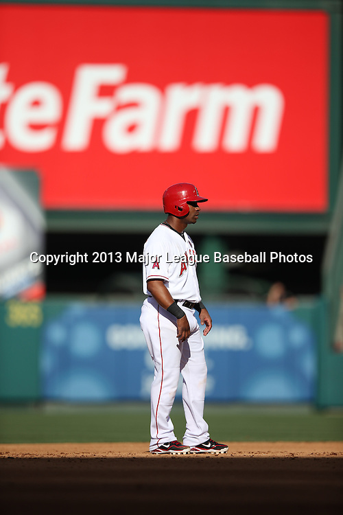 ANAHEIM, CA - JUNE 15:  Alberto Callaspo #6 of the Los Angeles Angels of Anaheim leads off second base in the late day sunlight during the game against the New York Yankees on Saturday, June 15, 2013 at Angel Stadium in Anaheim, California. The Angels won the game 6-2. (Photo by Paul Spinelli/MLB Photos via Getty Images) *** Local Caption *** Alberto Callaspo