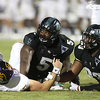 ORLANDO, FL - OCTOBER 14: Thomas Sirk #10 of the East Carolina Pirates, Jamiyus Pittman #5 of the UCF Knights and Tony Guerad #93 of the UCF Knights watch the replay board during a NCAA football game between the East Carolina Pirates and the UCF Knights at Spectrum Stadium on October 14, 2017 in Orlando, Florida. (Photo by Alex Menendez/Getty Images)