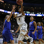 Moriah Jefferson, UConn, drives to the basket past Megan Rodkowa, DePaul,  during the UConn Vs DePaul, NCAA Women's College basketball game at Webster Bank Arena, Bridgeport, Connecticut, USA. 19th December 2014