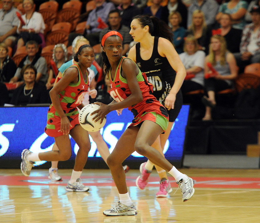 Malawis' Jessie Mazengera against New Zealand in the International Netball test at Pettigrew Green Arena, Napier, New Zealand, Sunday, October 27, 2013. Credit:SNPA / Ross Setford