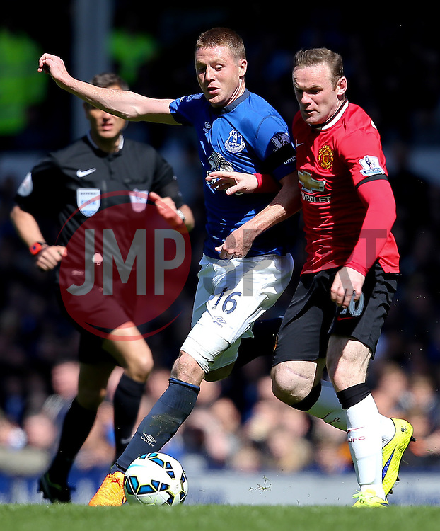 Everton's James McCarthy challenges Manchester United Captain, Wayne Rooney   - Photo mandatory by-line: Matt McNulty/JMP - Mobile: 07966 386802 - 26/04/2015 - SPORT - Football - Liverpool - Goodison Park - Everton v Manchester United - Barclays Premier League