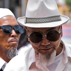 Two men with sunglasses. Kashgar, Xinjiang, China.