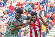Ellis Harrison (#22) of Portsmouth FC and Alim Ozturk (#5) of Sunderland AFC jump for a header during the EFL Sky Bet League 1 match between Sunderland and Portsmouth at the Stadium Of Light, Sunderland, England on 17 August 2019.