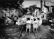 Breakfast in shanty town along railroad tracks in Tuol Kork, Phnom Penh, Cambodia.