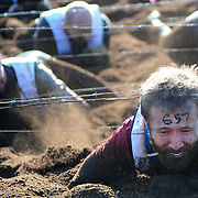 'Mudders' compete in the World's Toughest Mudder in Englishtown, New Jersey, USA. The event takes the top 10% of finisher in Tough Mudder events held around the world and places them against each other for 24 hours with the winner being determined by who can compete the most 10 mile laps. December 17, 2011.<br /> <br /> Picture by Jack Megaw | www.jackmegaw.com<br /> +44 7481 764811<br /> jack@jackmegaw.com<br /> 17/12/2011