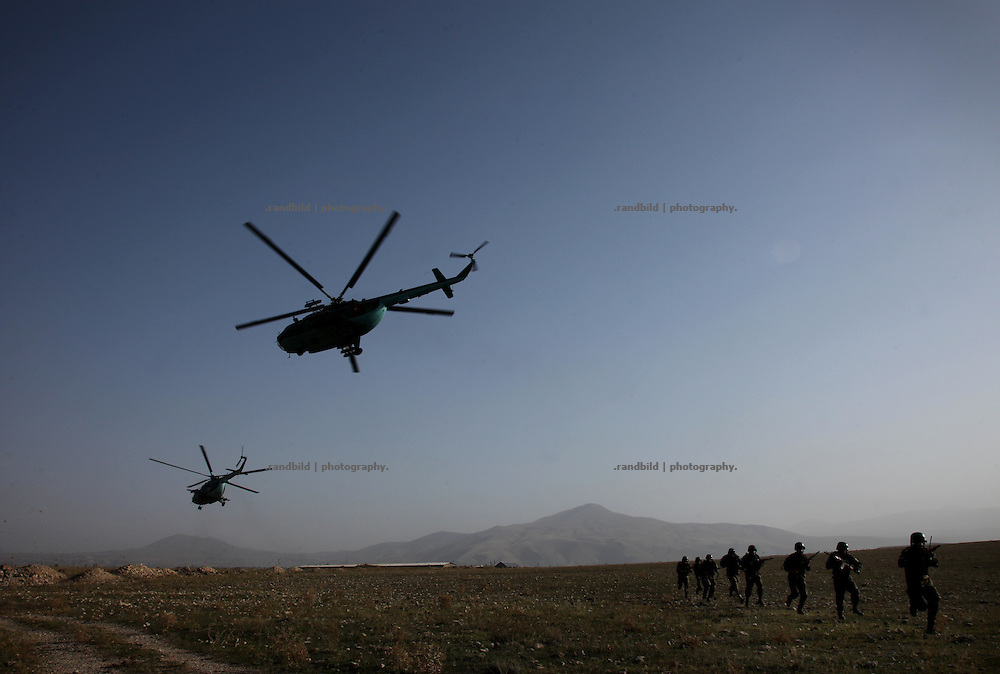 An armenian battlegroup getting an exercise to become trained for possible NATO peacekeeping missions abroad at a training area near armenian capital Yerevan. They exerciceing fightings and orderly checkpoint behavior.