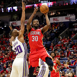 Oct 19, 2018; New Orleans, LA, USA; New Orleans Pelicans forward Julius Randle (30) shoots over Sacramento Kings forward Harry Giles (20) during the second half at the Smoothie King Center. The Pelicans defeated the Kings 149-129. Mandatory Credit: Derick E. Hingle-USA TODAY Sports