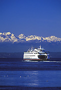 Image of Washington State Ferry on Puget Sound with snow capped mountains, Seattle, Washington, Pacific Northwest