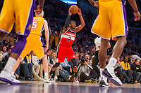 22 March 2013: Guard (2) John Wall of the Washington Wizards passes the ball against the Los Angeles Lakers during the first half of the Wizards 103-100 victory over the Lakers at the STAPLES Center in Los Angeles, CA.