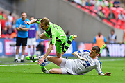 Tranmere Rovers Andy Cook(9) tackles Forest Green Rovers Mark Ellis(5) during the Vanarama National League Play Off Final match between Tranmere Rovers and Forest Green Rovers at Wembley Stadium, London, England on 14 May 2017. Photo by Adam Rivers.