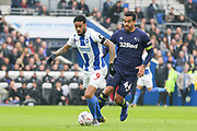 Brighton and Hove Albion striker Jurgen Locadia (9) battles with Derby County midfielder Tom Huddlestone (44) during the The FA Cup 5th round match between Brighton and Hove Albion and Derby County at the American Express Community Stadium, Brighton and Hove, England on 16 February 2019.
