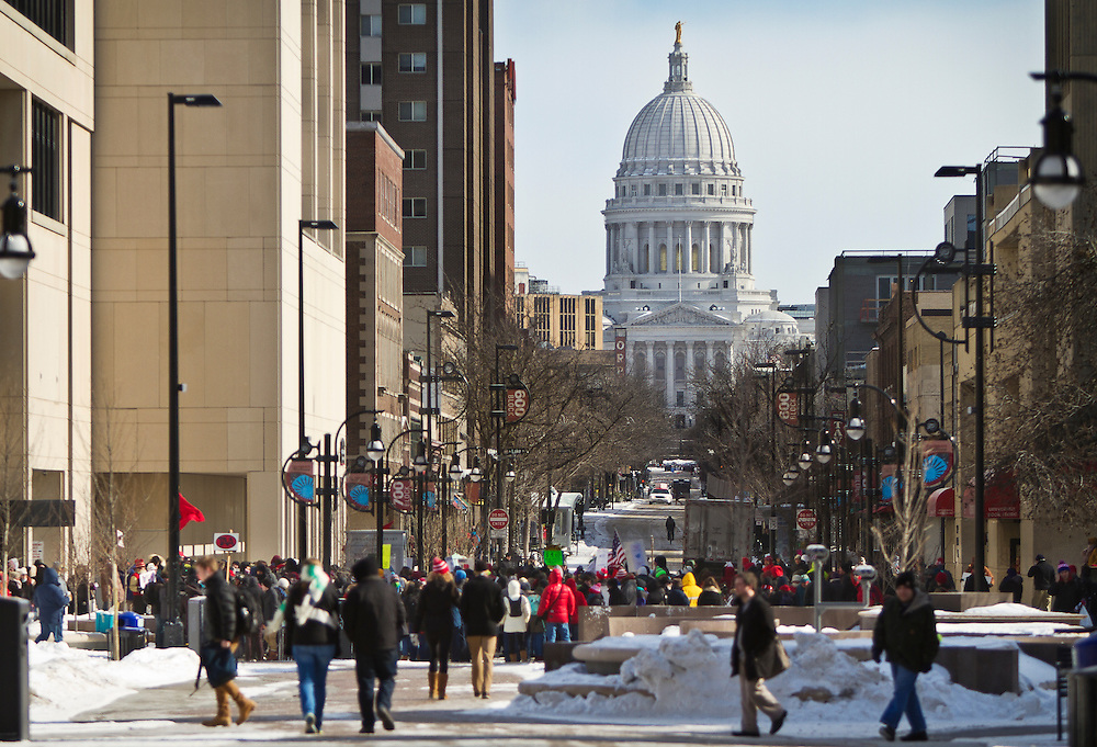 "MADISON, WI — FEBRUARY 13, 2015: Crowds begin to gather before the ""Stop the Cuts"" Rally on Library Mall, Saturday, February 14, 2015. The rally drew hundreds of student, faculty and community supporters in spite of the cold Midwest weather."