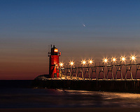 The PANSTARRS comet making an appearance over the lighthouse in South Haven Michigan.