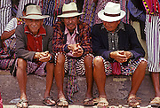 GUATEMALA, HIGHLANDS, MARKETS portrait of Indian men at market wearing traditional textiles, in village of Santiago on Lake Atitlan