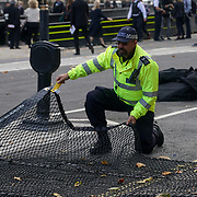 London, England, UK. 2nd October 2017. Police offical put mat on the road for security of Judges arrive at the Houses of Paliament for the Lord Cancellor's breakfeast.