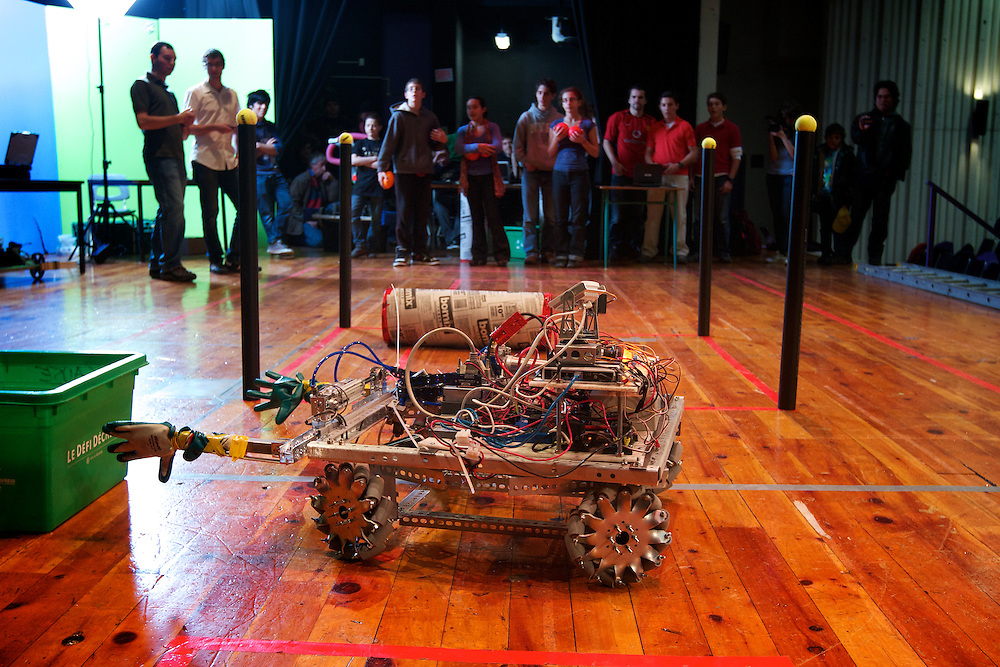 FIRST Robotics Quebec members run a mock trial session on November 19th, 2011 at Ecole Secondaire Saint Henri in Montreal, Quebec. The trial session was held two months before the launch of the 2012 FIRST Robotics competition to help students familiarize themselves with the competition's logistics, atmosphere and spirit.