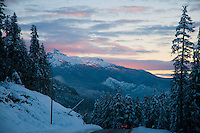The Black Tusk glows pink in the winter sunset, near Whistler, BC Canada