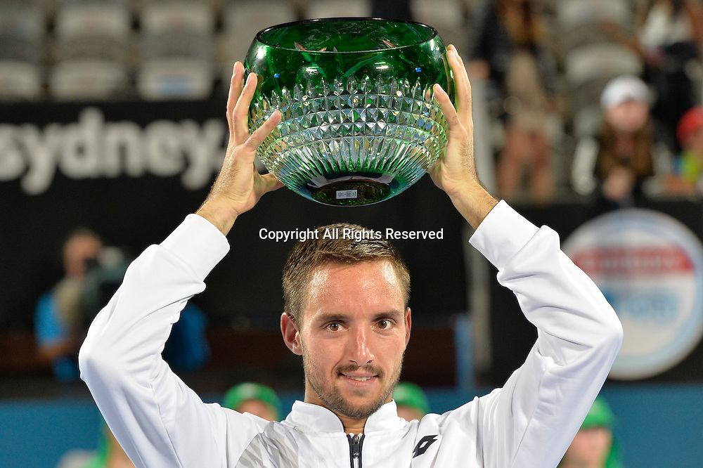 16.01.16 Sydney, Australia. Viktor Troicki (SRB) with trophy as he wins the mens singles title defeating Grigor Dimitrov (BUL) in the mens singles final match at the Apia International Sydney. He receives the trophy from Ken Roewall. Troicki won the final 2-6,6-1,7-6.