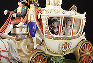 Bud and Marge Thurman own this large porcelain carriage that has followed them around the world and has been broken into hundreds of pieces and repaired.  Inside the carriage are Napoleon and Josephine. It's about two feet long.
