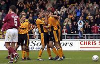 Photo: Richard Lane.<br />Northampton Town v Hull City. Nationwide Division Three. 04/10/2003.<br />Hull captain, Ian Ashbee congratulates Ben Burgess on his goal.