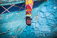 Detalle de una alpargata durante la festividad del Corpus Christi, representada en Venezuela a traves del ritual magico-religioso de los Diablos Danzantes. Los Diablos de Naiguata se identifican por pintar sus propios trajes y decorarlos con cruces, rayas y circulos, figuras que impiden que el maligno los domine. Las mascaras son en su gran mayoria animales marinos. Llevan escapularios cruzados, crucifijos y cruces de palma bendita. Naiguata, 30 Mayo 2013. (ivan gonzalez)