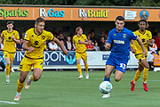 AFC Wimbledon midfielder Callum Reilly (33) battles for possession during the EFL Cup match between AFC Wimbledon and Milton Keynes Dons at the Cherry Red Records Stadium, Kingston, England on 13 August 2019.