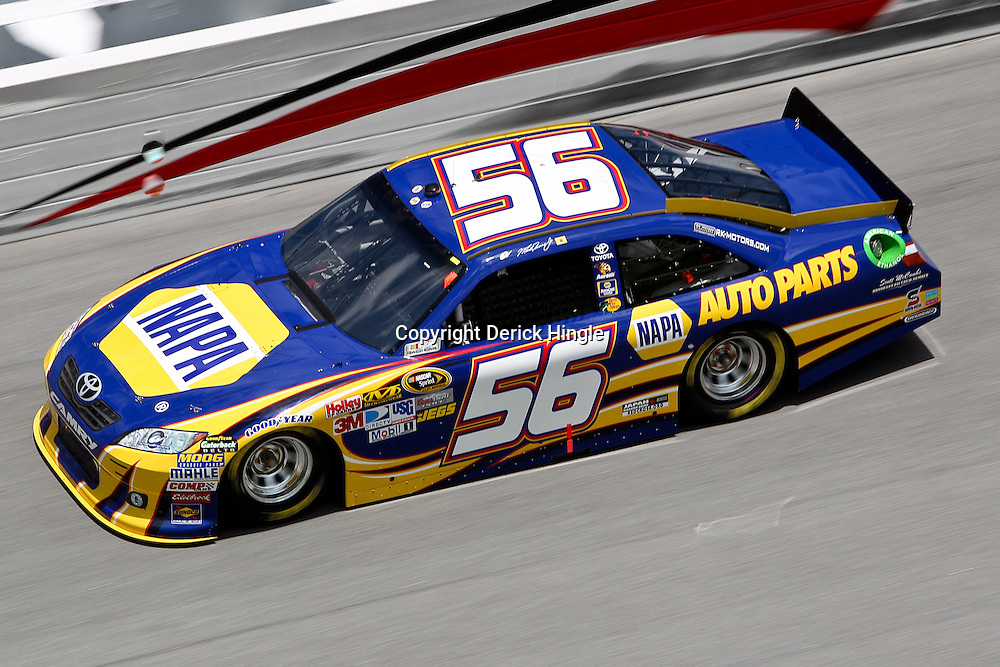 April 16, 2011; Talladega, AL, USA; NASCAR Sprint Cup Series driver Martin Truex Jr. (56) during qualifying for the Aarons 499 at Talladega Superspeedway.   Mandatory Credit: Derick E. Hingle