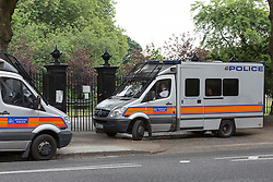 © Licensed to London News Pictures. 22/07/2016. LONDON, UK.  Police and police vans at the entrance of West Ham Lane Recreational Ground, known as Stratford Park on West Ham Lane in Stratford, where a man in his 20's was stabbed and killed yesterday afternoon. Two men were arrested nearby on suspicion of murder and taken into custody at an east London police station. Photo credit: Vickie Flores/LNP