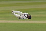 Tom Lace takes a painful blow fielding at short leg during the Specsavers County Champ Div 2 match between Middlesex County Cricket Club and Leicestershire County Cricket Club at Lord's Cricket Ground, St John's Wood, United Kingdom on 17 May 2019.