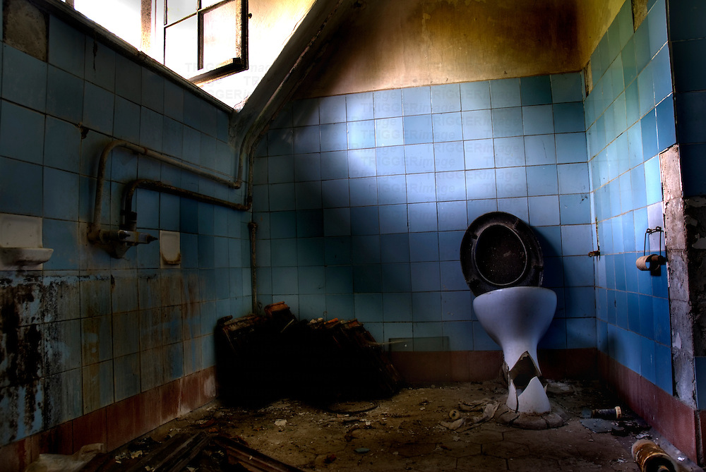 Derelict toilet old Soviet military hospital in East Germany