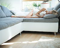 Woman sleeping on sofa at home