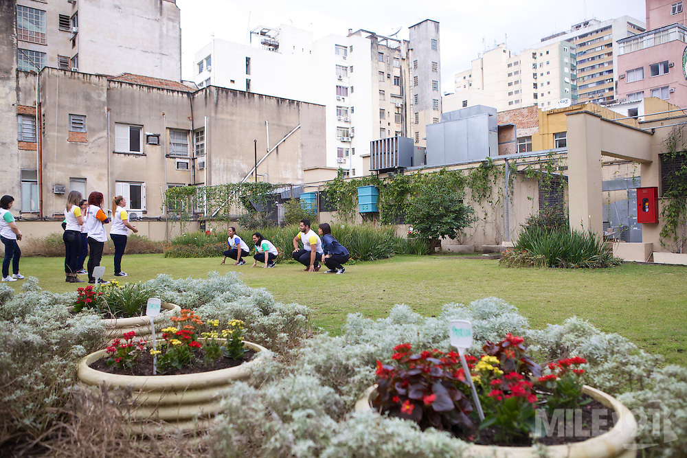 C&A Instituto volunteers playing a game on the grassy roof of the eco store in Porte Alegre, Brazil.