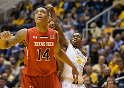 West Virginia Mountaineers guard Juwan Staten (3) shoots a three pointer against the Texas Tech Red Raiders during the first half at the WVU Coliseum.