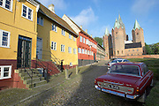 Old town centre with church and vintage Ford 20M.