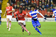 Bambo Diaby of Barnsley FC and Eberechi Eze of Queens Park Rangers during the EFL Sky Bet Championship match between Barnsley and Queens Park Rangers at Oakwell, Barnsley, England on 14 December 2019.