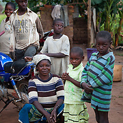 Bridjet Mbahiga with her children. She is mother of 4 and runs a subsistence plot of land to feed the kids yams, agash and rice. Benue state has got one of the highest HIV prevalence in Nigeria and EVA aim to target vulnerable children who would otherwise miss out of being tested for HIV and therefor not know their HIV statues. EVA runs a programme in the community called Window of Hope where children once a week meet to find support with each other and to receive psycho-social help. Many of the children are from HIV effected families and live precarious lives.  Education As a Vaccine Against Aids (EVA) in Nigeria.Education As a Vaccine Against Aids (EVA) in Nigeria.