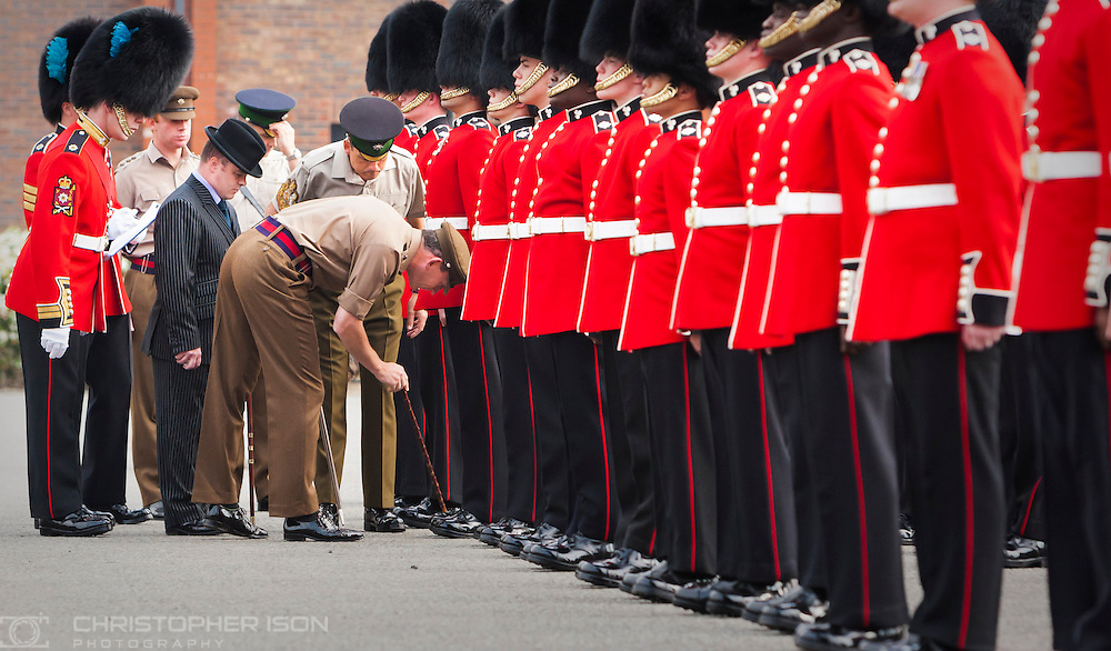The guardsmen of the Irish Guards are inspected in minute detail at their barracks in Windsor by their Commanding Officer Lt Col Chris Ghika as they prepare for their ceremonial duties during the wedding of Prince William and Catherine Middleton.