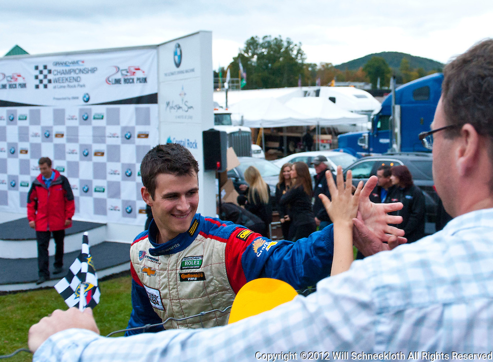 Stevenson Motorsports Chevrolet Camaro driver John Edwards celebrates with fans following victory in the Grand-Am Rolex Sports Car Series Championship Race at Lime Rock Park in Lakeville, Conn.