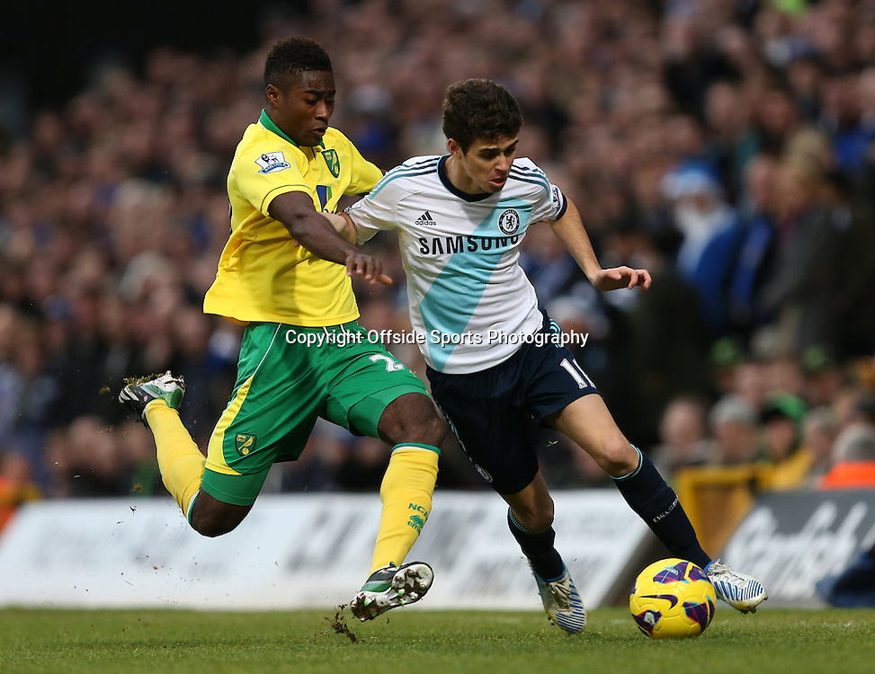 26th December 2012 - Barclays Premier League - Norwich City vs. Chelsea - Alexander Tettey of Norwich slides in to tackle Oscar of Chelsea - Photo: Simon Stacpoole / Offside.
