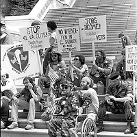 Agent Orange protestors sit on the steps of the U.S. Capitol Building in Washington, DC on May 13, 1982.