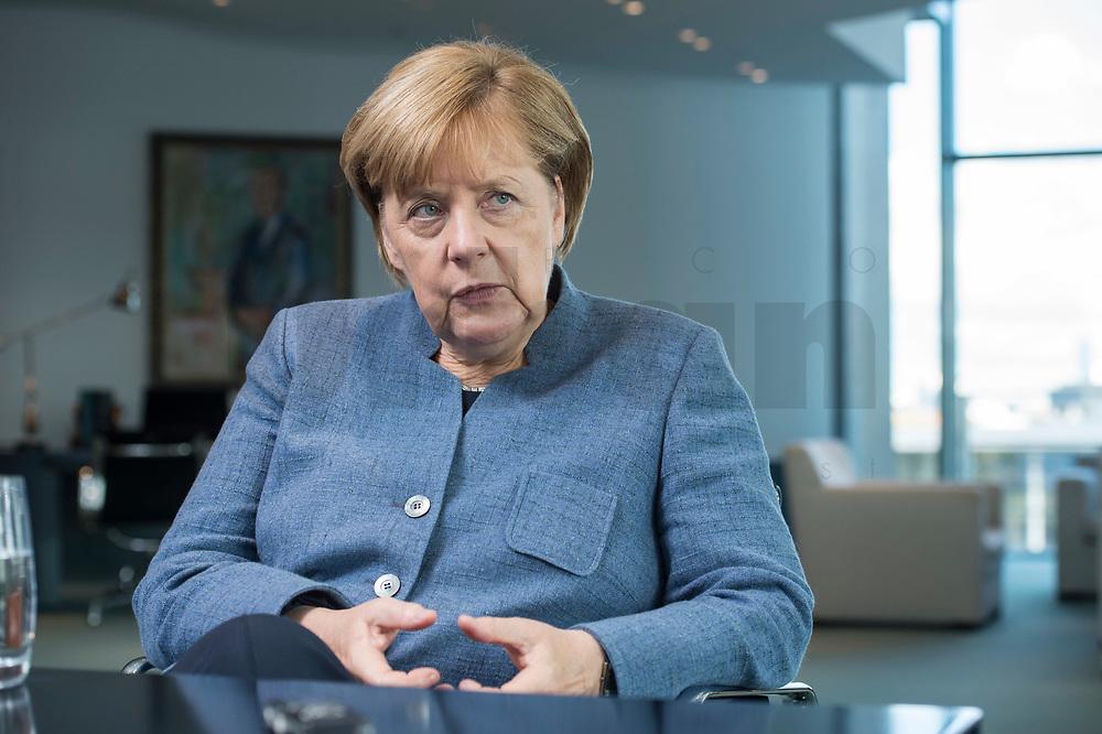09 OCT 2017, BERLIN/GERMANY:<br /> Angela Merkel, CDU, Bundeskanzlerin, waehrend einem Interview, in ihrem Buero, Bundeskanzleramt<br /> IMAGE: 20171009-01-010<br /> KEYWORDS: B&uuml;ro